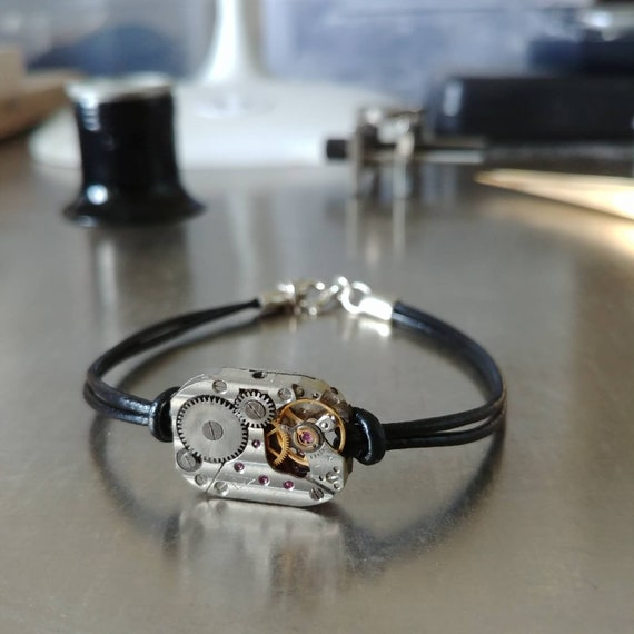 Mens bracelet black leather with a watch mechanism