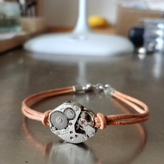 Men bracelet leather nude and old watch mechanism