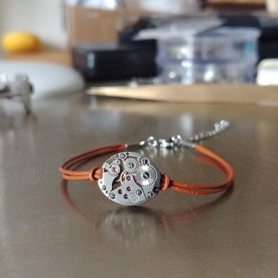 Tissot watch movement on brown leather women bracelet
