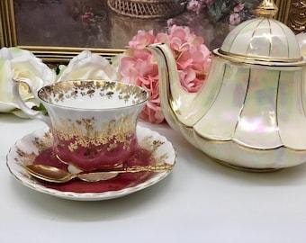 Royal Albert Regal Series teacup and saucer in pink.