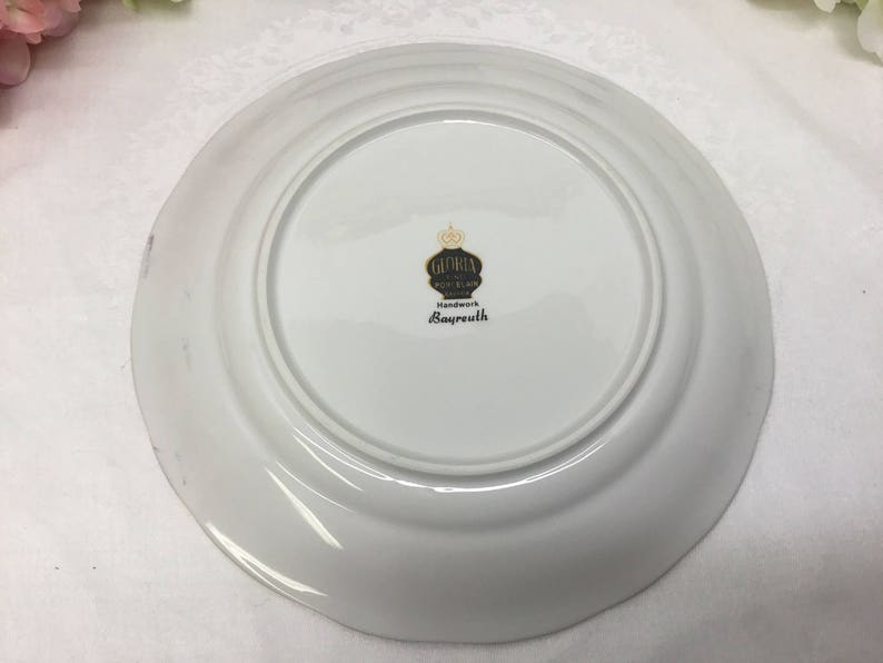 Fine porcelain dessert plate with handle.