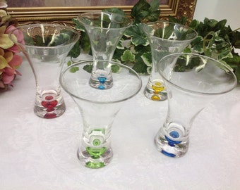 Gorgeous shot glasses with color imbedded in glass.