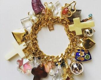 1980 Vintage religious theme charm with crystal gold tone bracelet