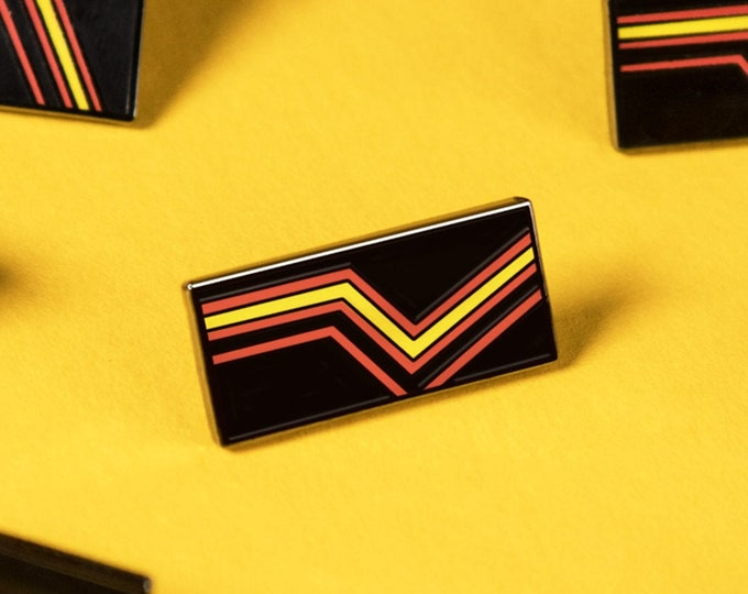 The Rubber Pride Flag Enamel Pin