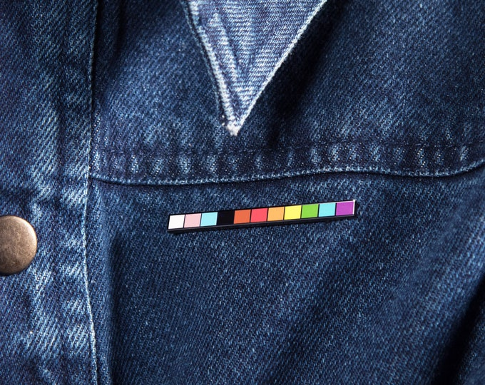 The LGBT Progress Rod Enamel Pin
