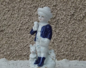 Vintage German boy and the porcelain hare figurine collectible