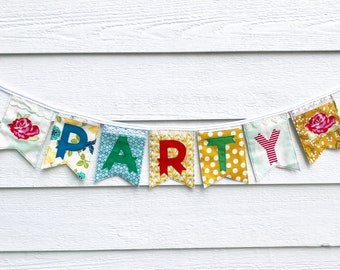 PARTY banner made from new repurposed and vintage fabrics and lace