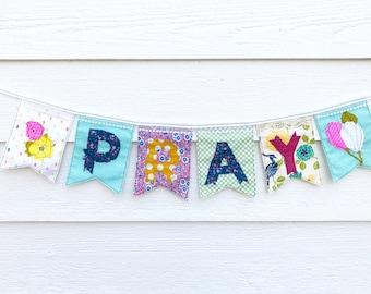 PRAY banner