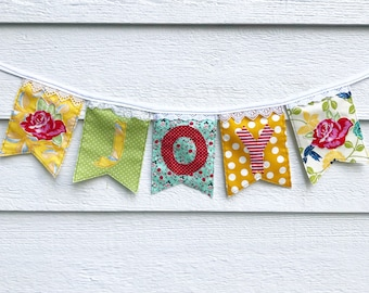 JOY banner made from new repurposed and vintage fabrics and lace