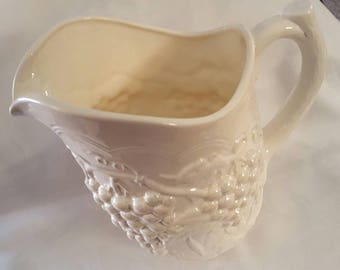 Large ceramic water pitcher signed