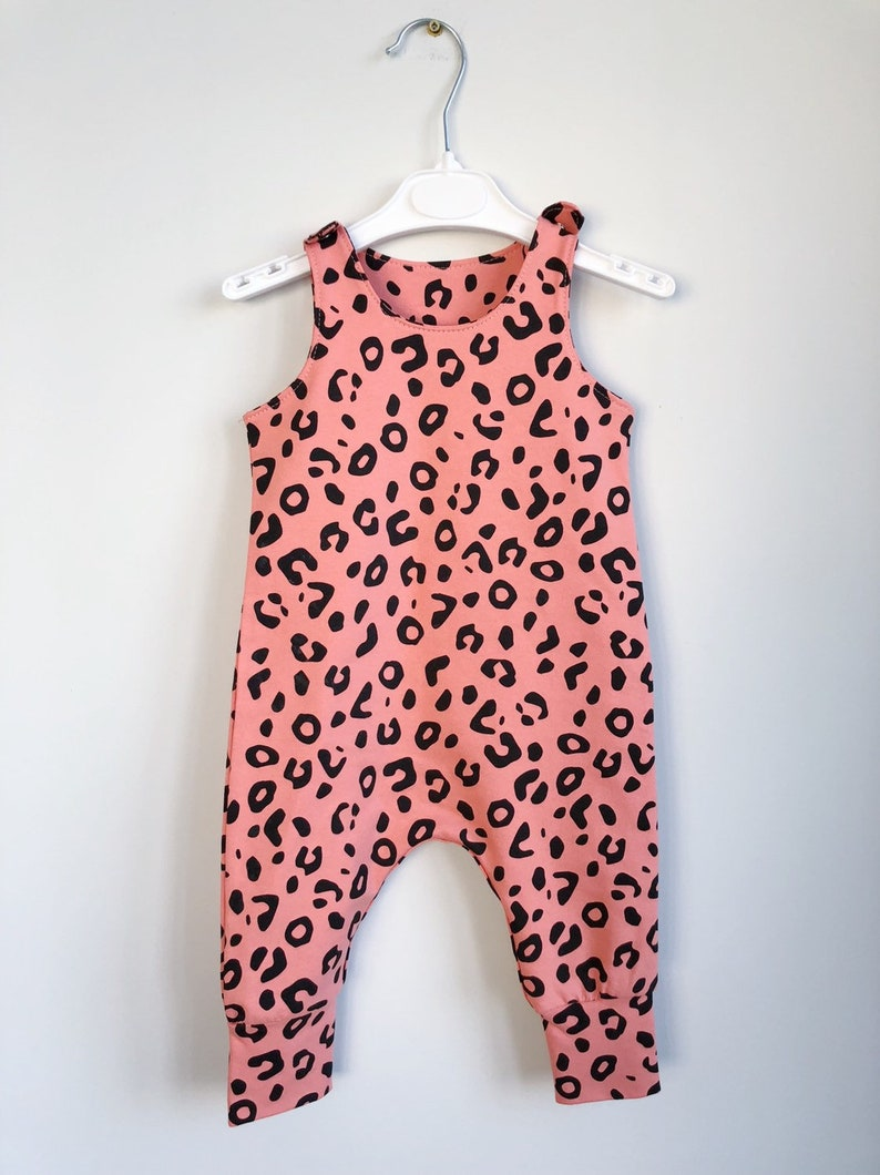3707d6fbf16 Coral Baby romper with spotted print baby dungarees bunny