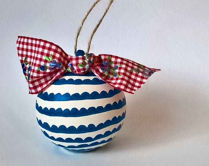 Hand drawn ceramic bauble with vintage ribbon
