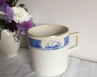 Large vintage ceramic mug.