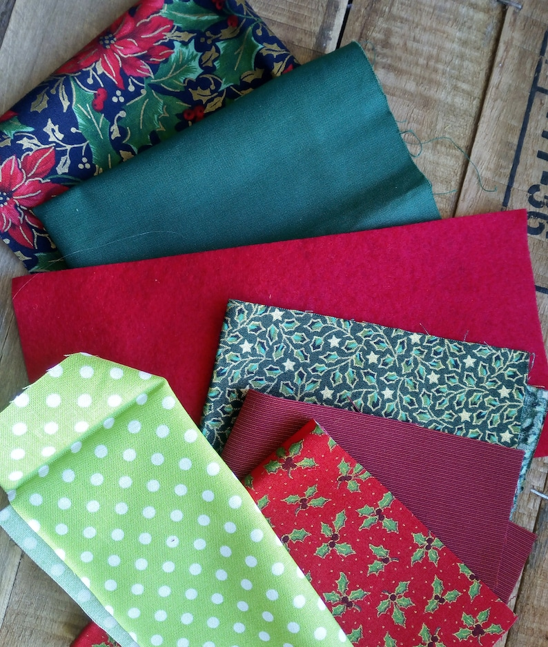 inspirational fabric pack for slow stitching containing traditional red and green elements Christmas textile bundle