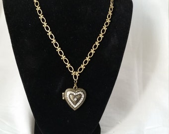 Brass heart locket with little CZ stones around it