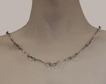 Be original! wear this Asymmetrical Chain.