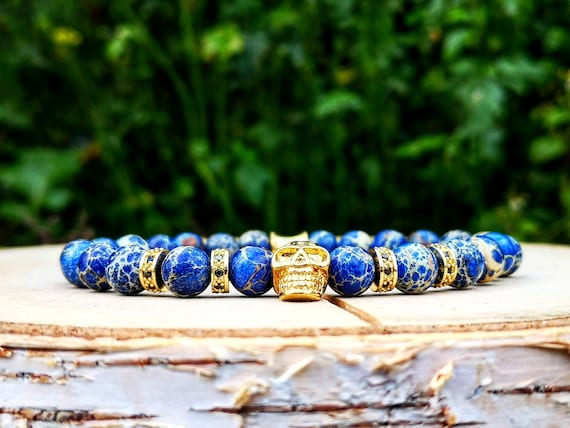 Golden beaded skull bracelet for men and women, Gift for him and her, Blue ocean beads, Stretch bracelet, Jewelry for men