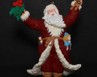 "Hallmark VINTAGE Christmas Ornament ""Merry Olde Santa"" -9th In Merry Olde Santa Series-Santa W/Dolls In His Pockets, Holding Holly And Bells"
