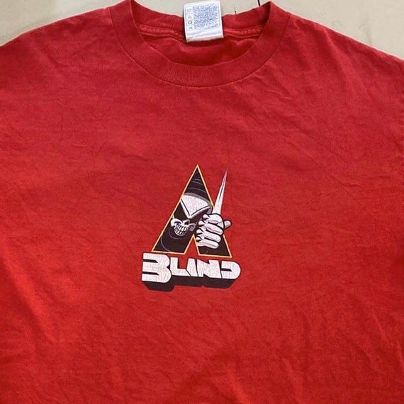 Vintage Blind skateboards T shirt rip off a clockw