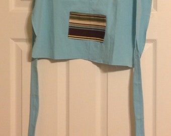 Apron in blue with muti-trim pocket