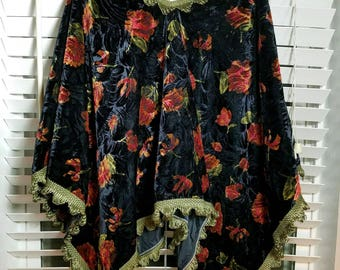 Beautiful Poncho/Shaw. Velvet material in blue/black with rose flowers. Trimmed in green. Can be worn 2 ways.