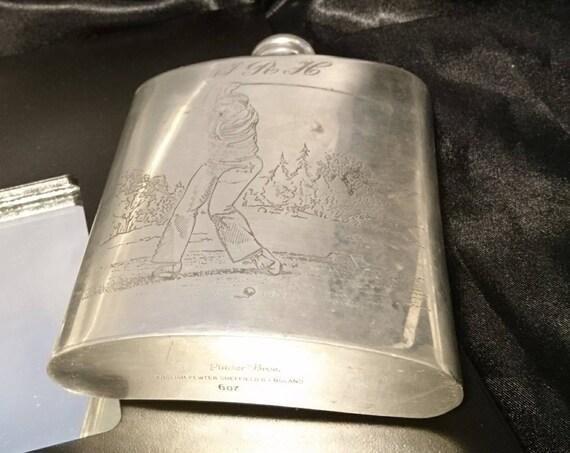 A fantastic vintage Pinder Bros Pewter hip flask, golfing design, monogrammed JRH, 8oz Pewter hip flask
