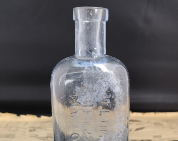 Antique blue glass bottle, Masons Wine Essences
