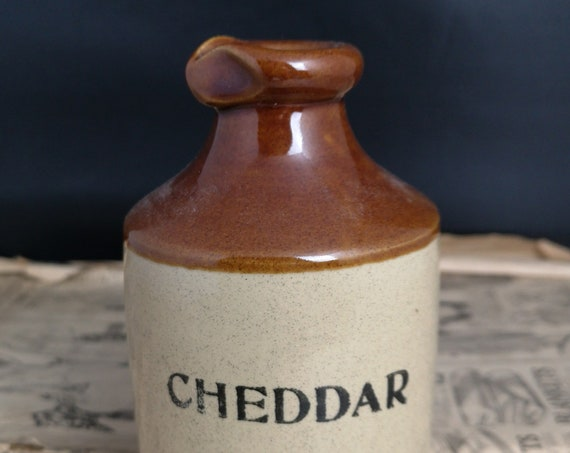 Vintage stoneware bottle, rustic kitchen decor, Cheddar