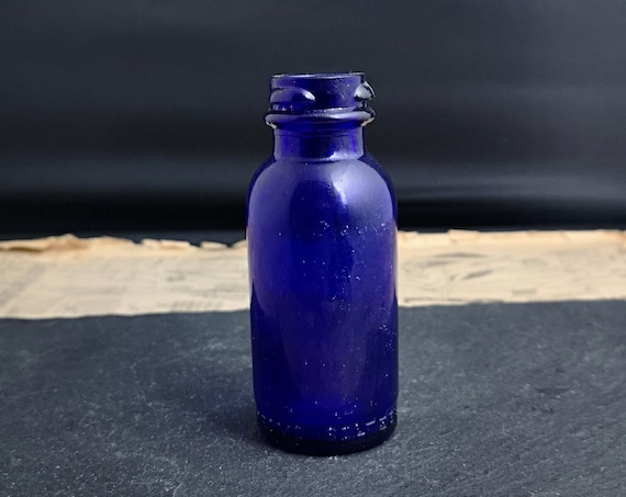 Vintage cobalt blue glass medicine bottle, Bromo Seltzer