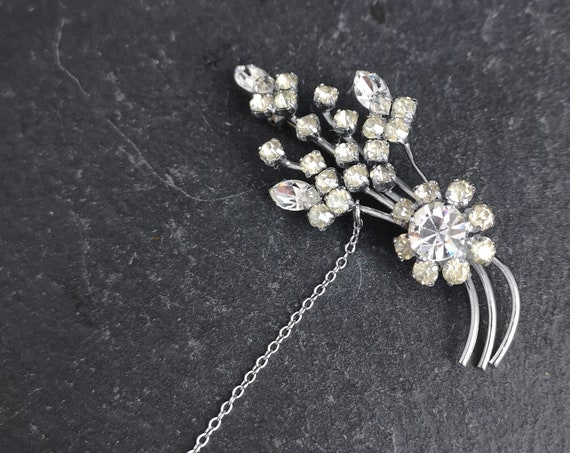 Vintage diamanté and paste spray brooch, silver tone