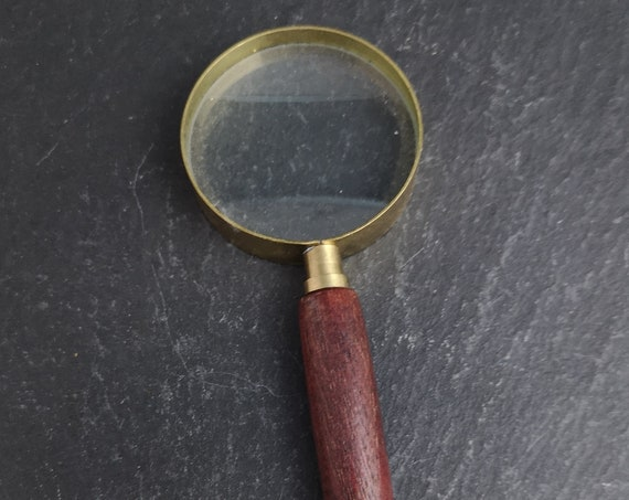 Vintage magnifying glass, wood and brass