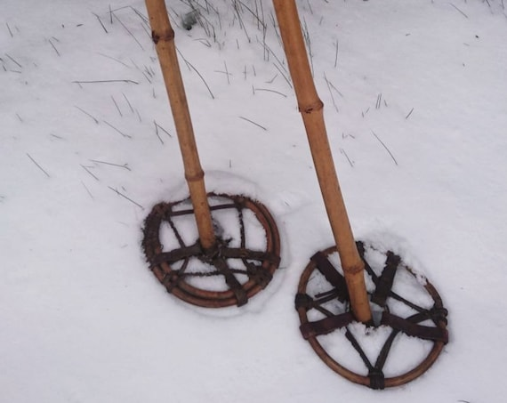 Antique bamboo ski poles, leather and metal fixtures, antique skiing