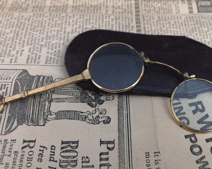 Antique lorgnettes, Edwardian gilt metal, folding spectacles, leather case