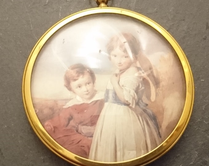 Antique brass picture frame, small circular hanging frame, convex glass, gilt brass