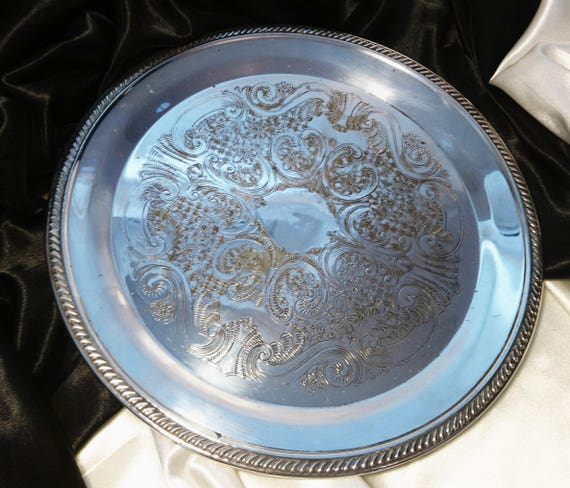 Vintage silver plated serving tray, FB Rogers USA, silver plate on copper, round tray