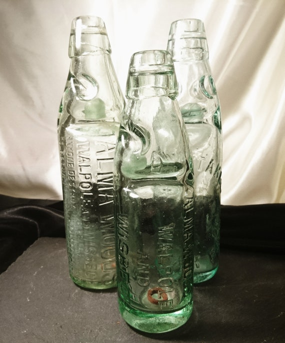 Antique bottles, green glass codd bottles, soda, beer, early glass, Victorian era