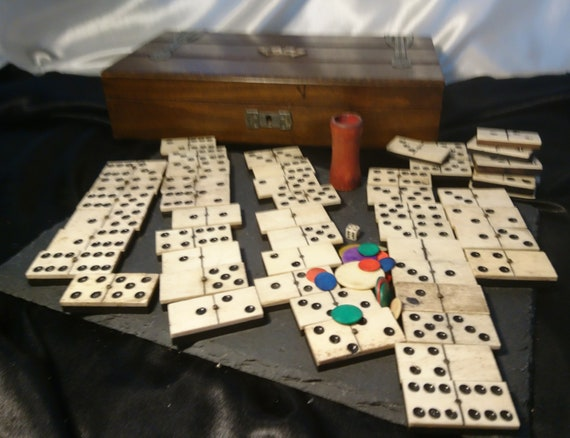 Antique games box, bone dominoes, dice, counters, large oak and enamel games box, Victorian dominoes