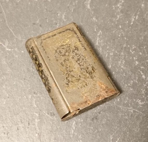 Worn antique metal match safe and striker, japanned metal, vesta case