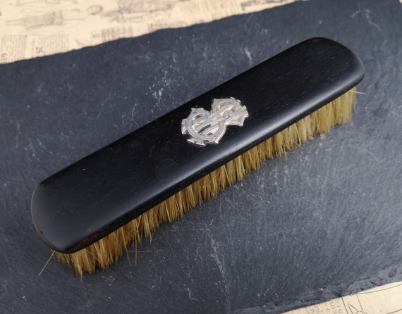 Antique ebony and silver clothes brush