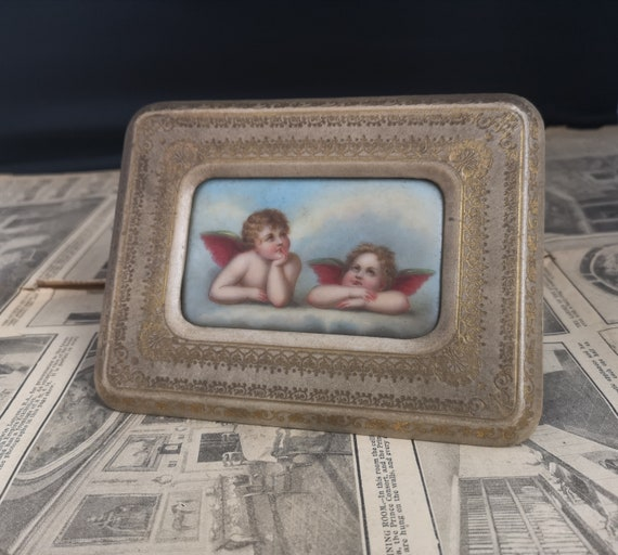 Antique Italian porcelain plaque of putti, cherubs, gilt embossed leather frame, painting, signed