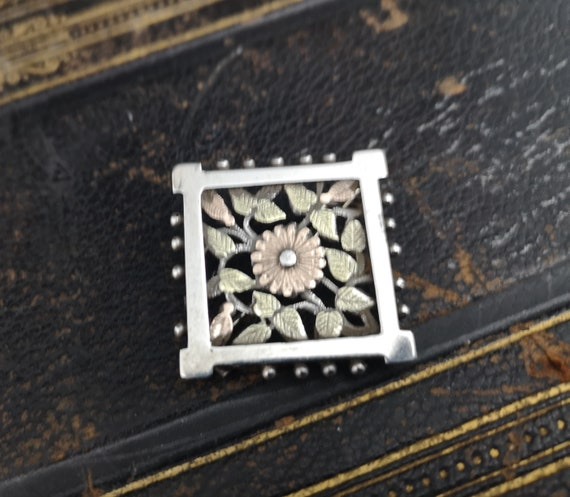 Antique silver and gold floral brooch, Victorian aesthetic era