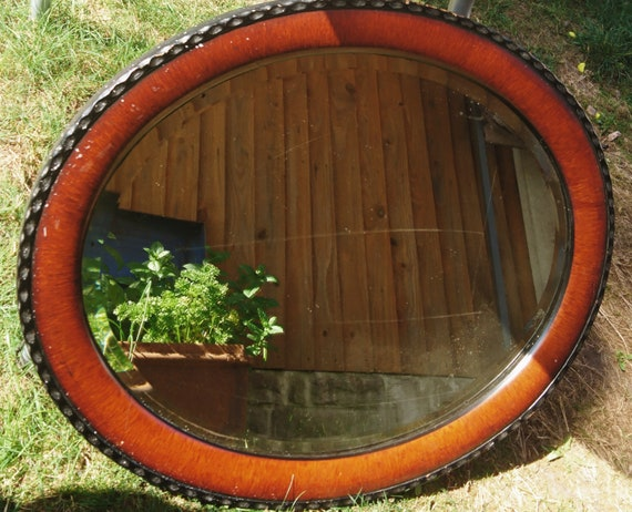 Large Victorian oval mirror, mahogany and ebonised frame, pie crust edge, antique mirrors