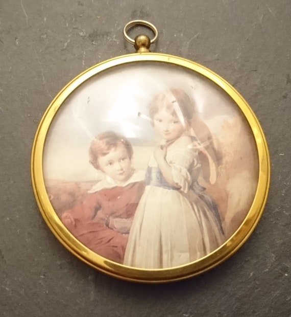 Antique brass picture frame, small circular hanging frame, convex glass, gilt brass
