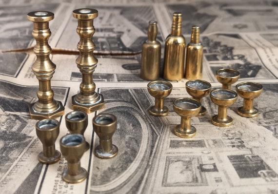 Vintage brass dolls house miniatures, wine bottles, goblets, glasses and candlesticks, dolls accessories