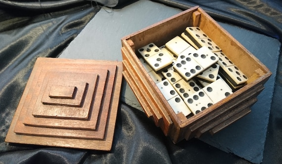 Antique bone dominoes, bone and ebony, tramp art box