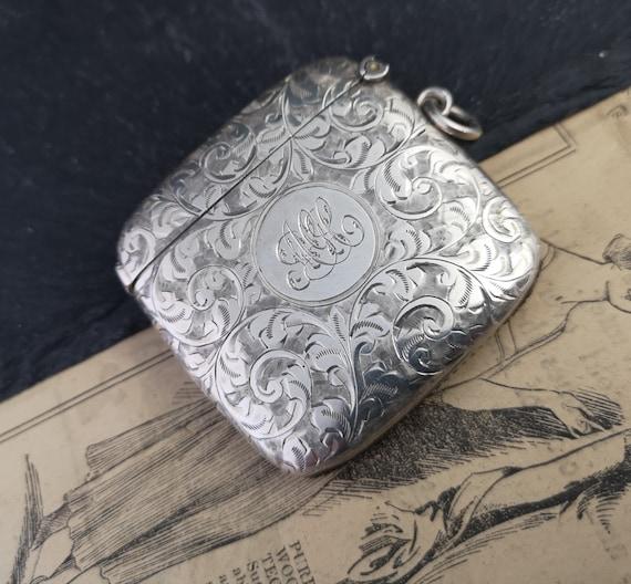 Antique sterling silver vesta case, engraved