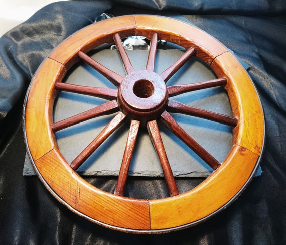 Antique wooden cartwheel with brass rim, decorative, rustic decor