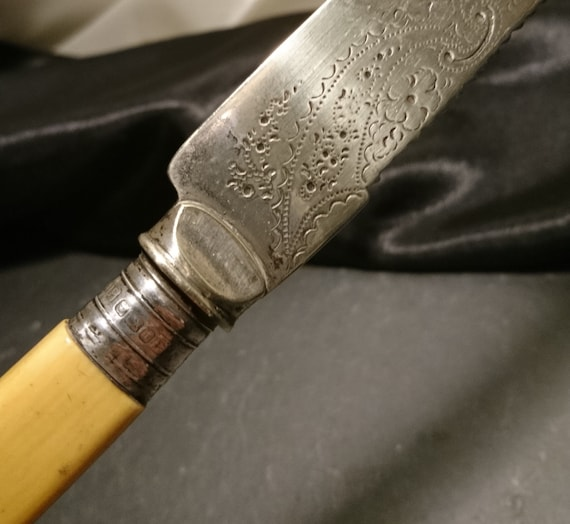 Antique bread knife, silver, steel and bone, decorative engraved kitchen knife
