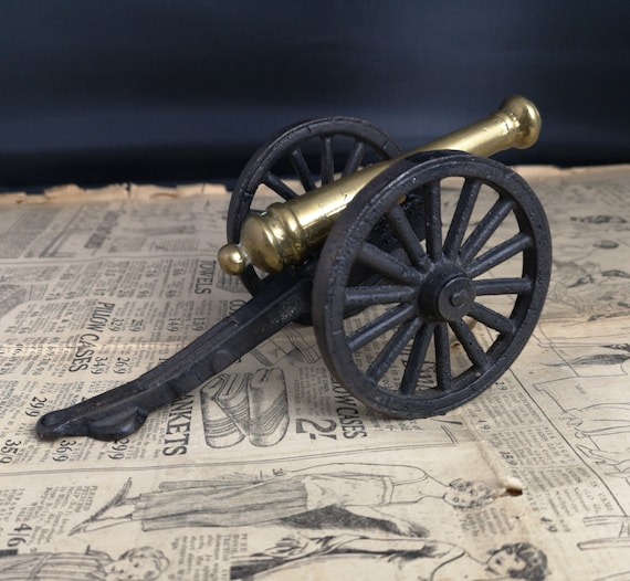 Antique cannon desk model, Victorian cast iron and brass cannon