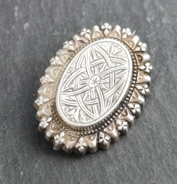 Antique Victorian silver aesthetic brooch